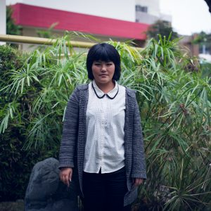 Karen Kina, 3rd generation, lived in Japan twice. The first time when she was a child for three years. The second as a young adult, to work in a factory for two years. The family came back to Peru for her mother to get some medical treatment. Peruvian Japanese Cultural Centre, Jesus Maria district, Lima, 2017. / Karen Kina, 3ème génération, a vécu deux fois au Japon. La première lorsqu'elle était enfant, pendant trois ans. La deuxième, déjà jeune adulte, pour travailler dans une usine pendant deux ans. Sa famille est revenue au Pérou pour que sa mère reçoive un traitement médical. Centre Culturel péruvien-japonais, quartier Jésus Maria, Lima, 2017.